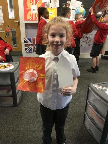 Lucy created a sword and shield from cardboard