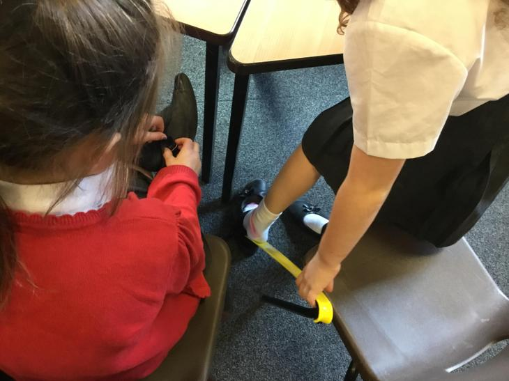 The shoehorn helps people who can't bend down
