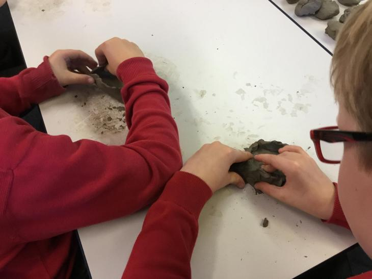 We started to mold the clay.
