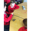 Creating our own circuits with bulbs and switches.