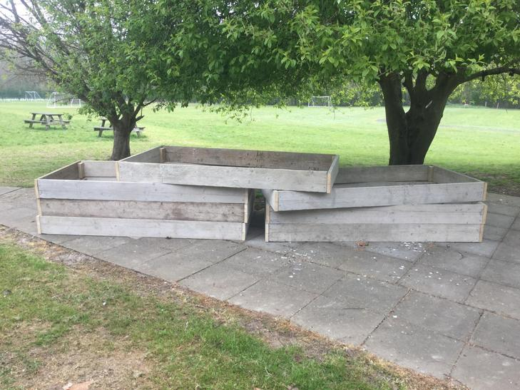 Seven raised beds built out of donated scaffold boards!