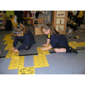 Working together to build the yellow brick road.