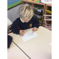 Reading sentences and highlighting tricky words.