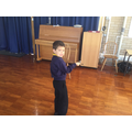 Acting out the story of Little Red Riding Hood.