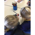 Helping each other to read the sentences.
