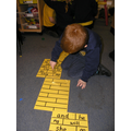 Reading tricky words on the yellow brick road.