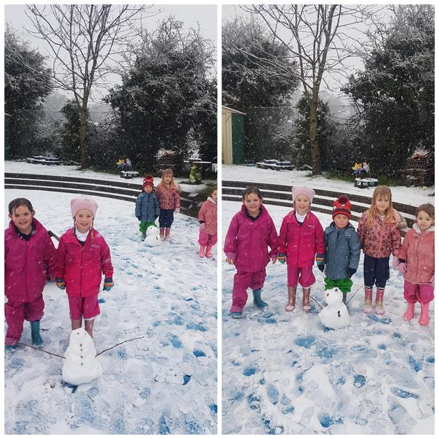 Building snowmen on a snowy day.