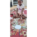 She made a sun with paper and colouring pencils