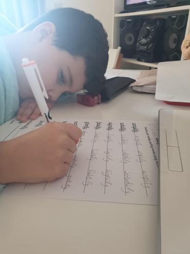 Pedro (Orange) working hard in spellings