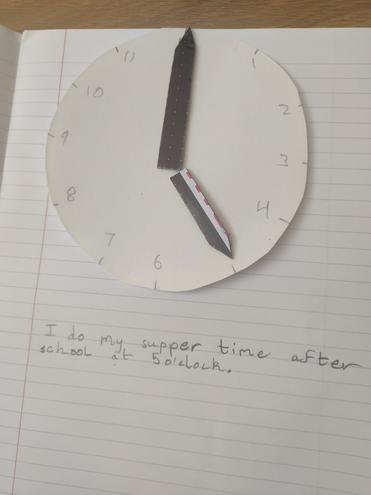 Maths-telling o'clock time by Aditya, Blue class