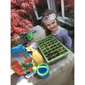 Nala doing some planting.