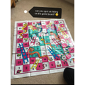 Hiding on the snakes and ladders board at Bradley's house