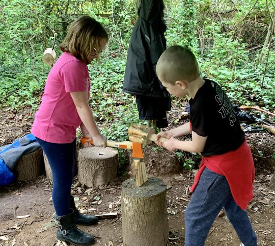 Using the hand axe to split fire wood