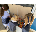 We enjoy reading at playtime. We can choose a book to read from our playtime book boxes