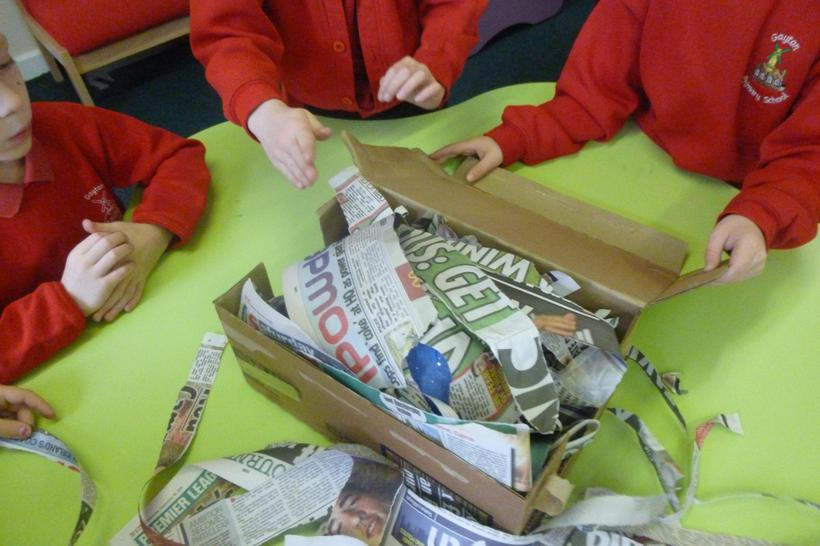 Cover with more newspaper strips,