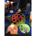 Sorting objects into Magnetic and Non-Magnetic groups during an adult-led activity.