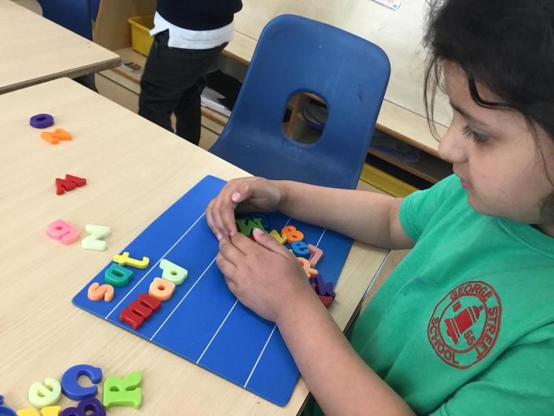 Using magnetic letters independently to create words