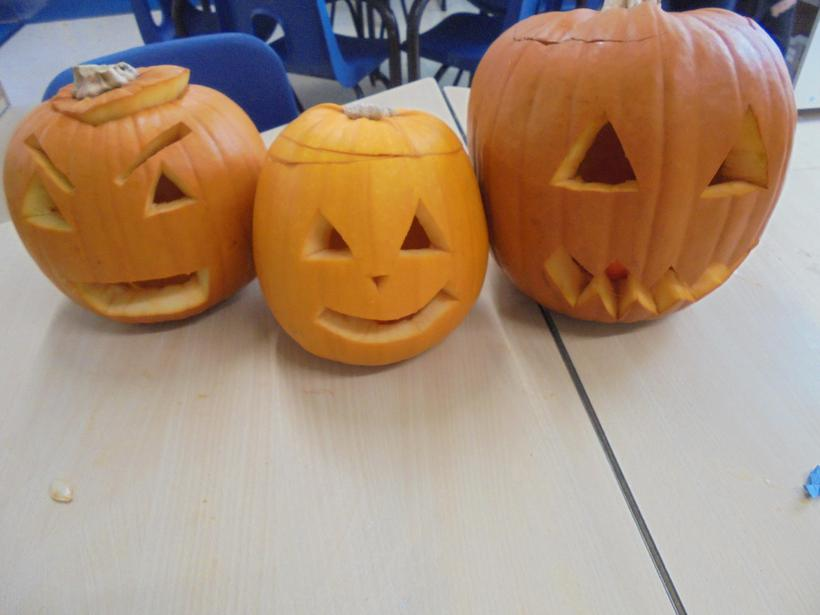 The teachers helped us to carve faces.