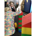 The children have followed a repeating pattern to build their walls.