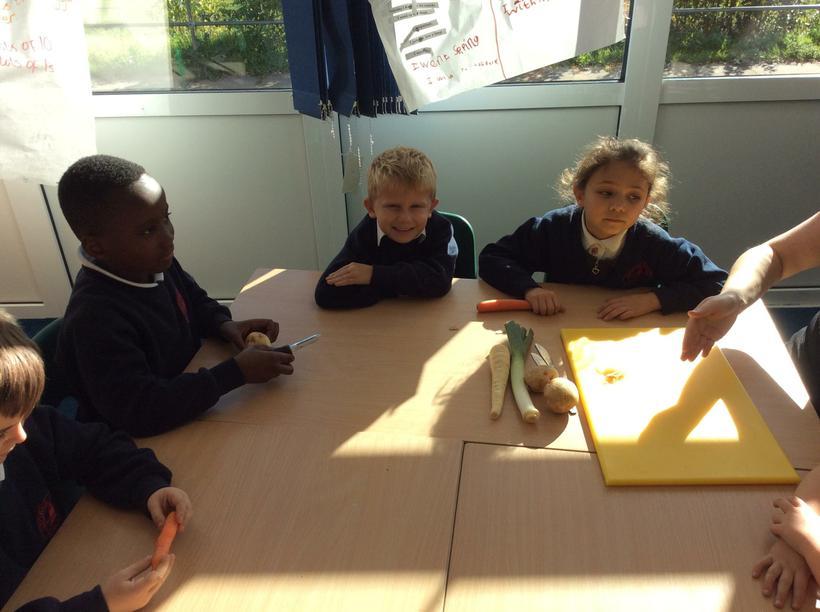 Quinn, Jack and Louis preparing their vegetables.