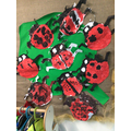 Creating our very own lady birds with groups of spots.
