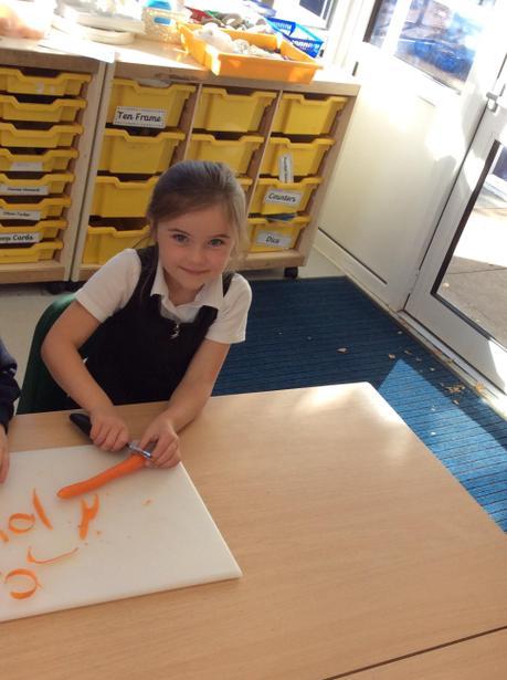 Lydia peeling a carrot.