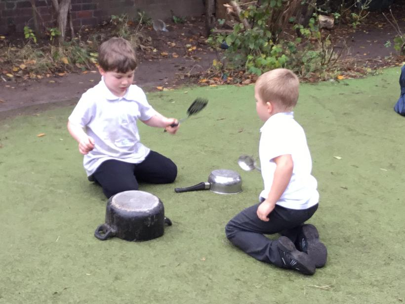 Creating our own steel drums in our outside area