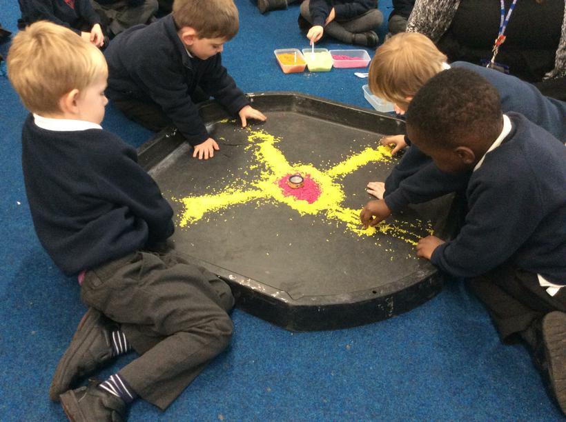 We used coloured rice to make a rangoli pattern