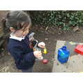 Creating a perfume using flowers, mud and water.