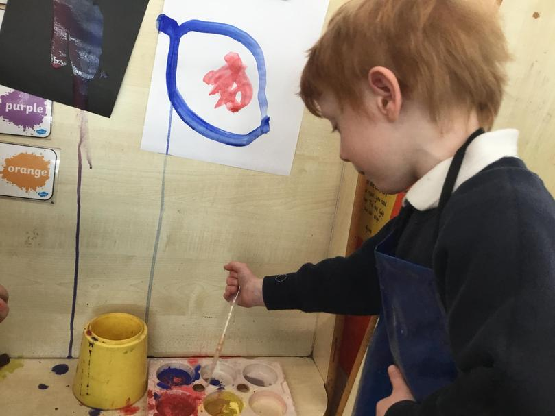 """Mixing powder paints to create artwork. This painting was of """"the centre of the Earth"""""""