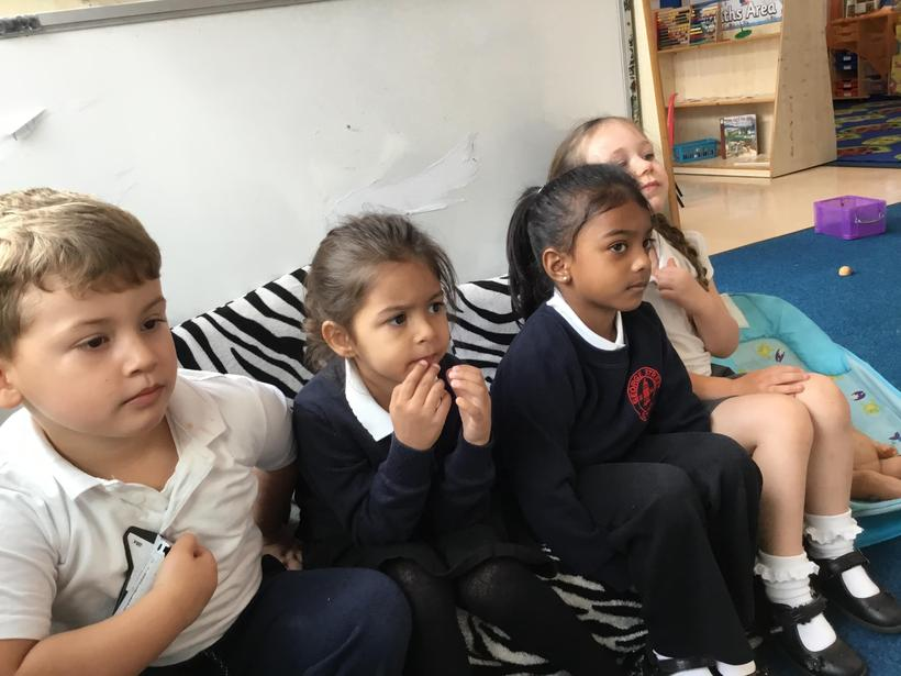Peers eagerly listening to the story