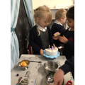 Engaging in role play with friends, singing 'happy birthday' and blowing out the candles!