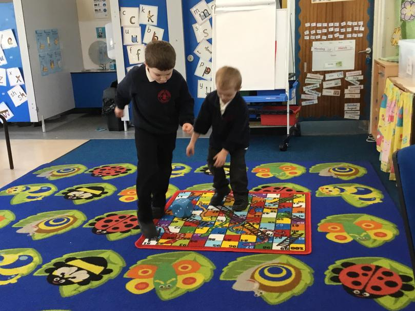 Playing games such as Snakes and Ladders with peers