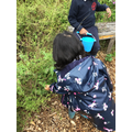 Smelling the herbs in the sensory garden.