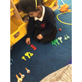 Exploring the maths resources and sorting them into colour groups.