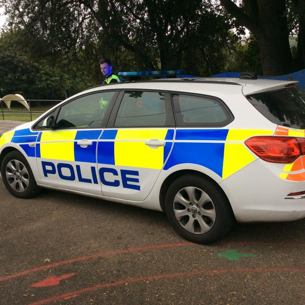 The police car had flashing blue lights and a sire