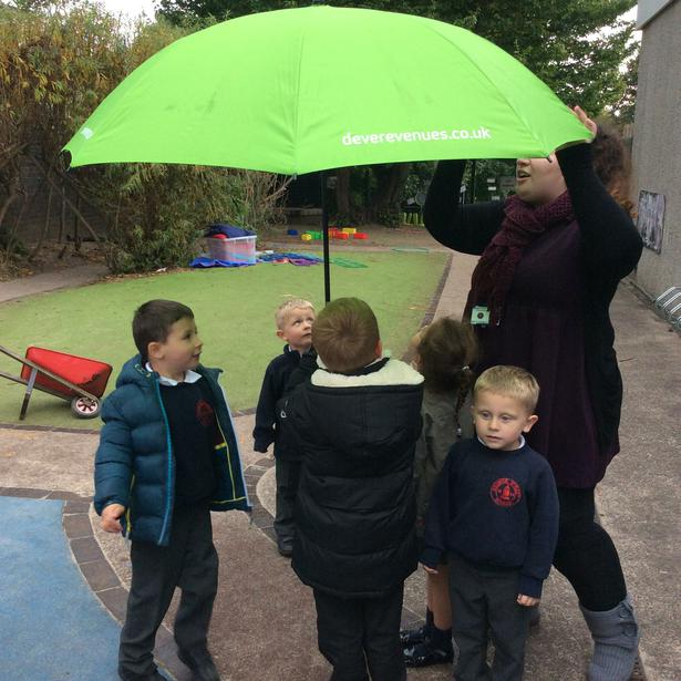 We could see the rain falling on the umbrella.