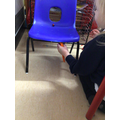 Experimenting with magnets by watching how the magnetic ball can move through the chair!