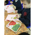 Mixing and pouring our own coloured paints for our pictures.
