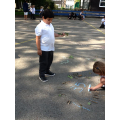 Forming our numbers on the playground using chalk.