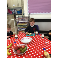 Cutting our fruit at snack time.