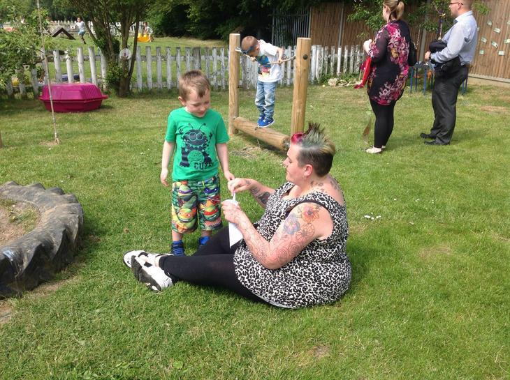 Blowing bubbles with Mummy.