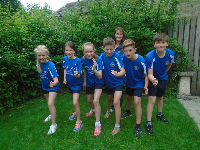Y5/6 sport the new kit with governor Beccy Bullock