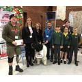 Year 6 children presenting the cheque
