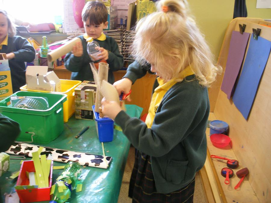 The children use a range of materials to create