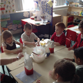 Making playdough to investigate the number five.