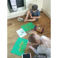 Matthew and his sister busy making dino pictures!