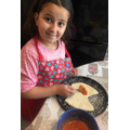 Romayssa made pizza with fresh dough!