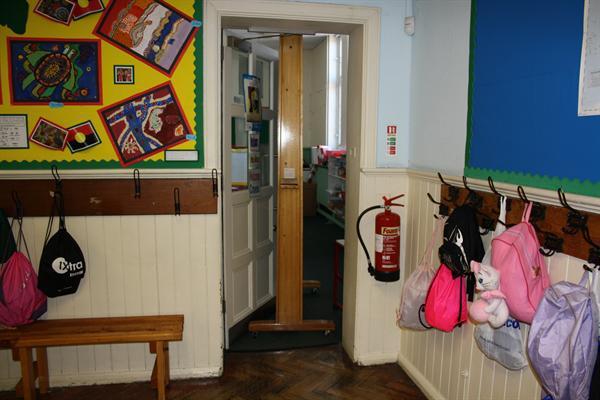 The blackboard gets stuck in Mrs Kearns' doorway.