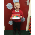 Nursery:  This young man is recognising numbers to 10 and is being a super helper!